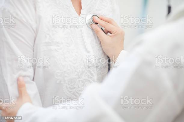 Doctor asian woman medical professional examining patient with and picture id1152378548?b=1&k=6&m=1152378548&s=612x612&h=75t0b4 39 udslxx8 psbvifmapsz9atnc1gfdowpay=