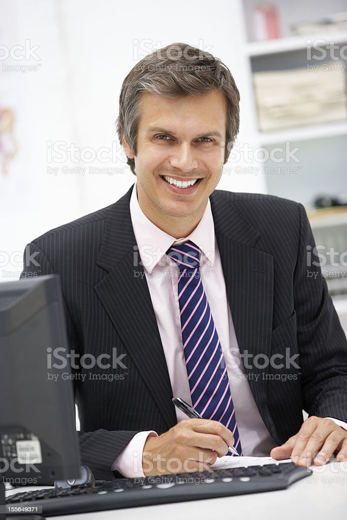 Doctor at desk royalty-free stock photo