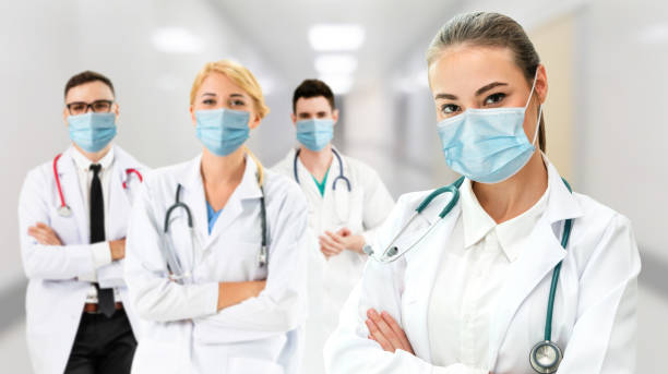 Doctor at hospital wearing medical mask to protect against coronavirus 2019 disease . stock photo