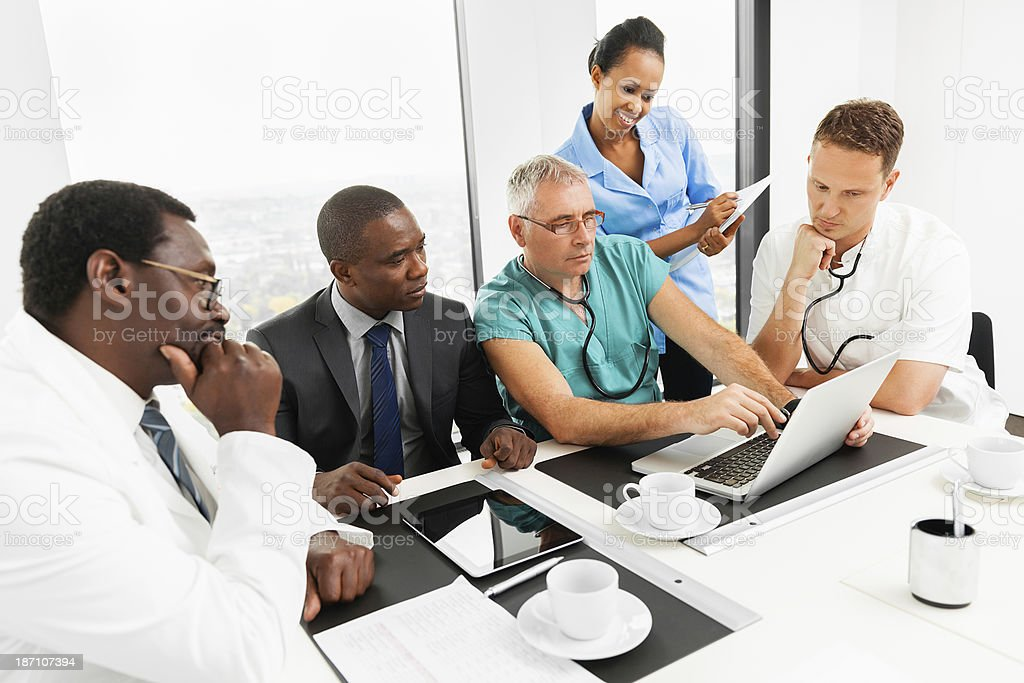 Doctor at meeting with colleagues royalty-free stock photo