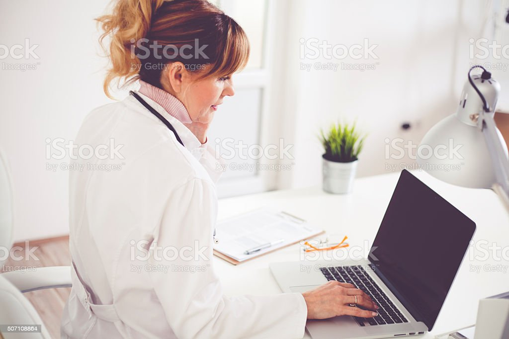 Doctor at office stock photo