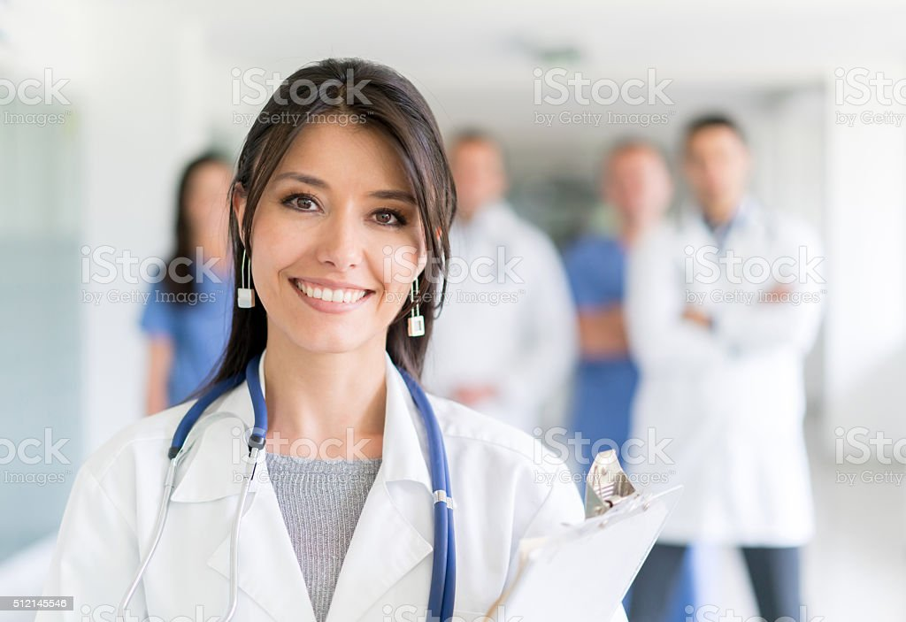 Doctor at the hospital with medical staff stock photo