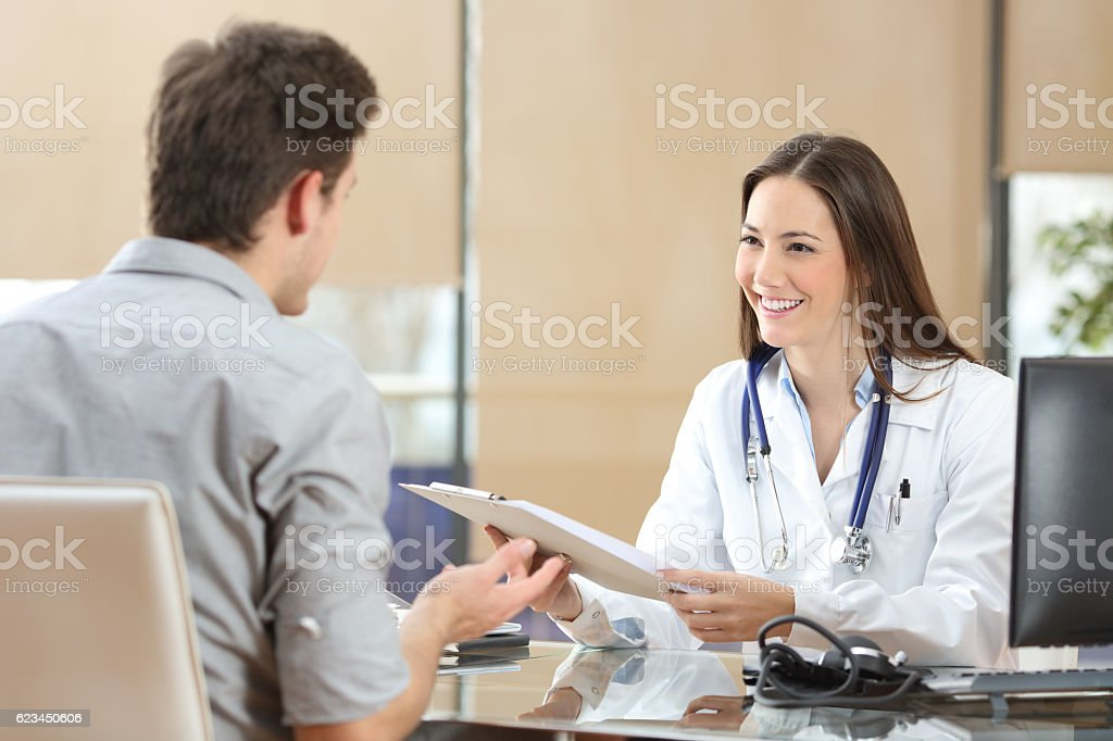 Doctor attending a patient in a consultation stock photo