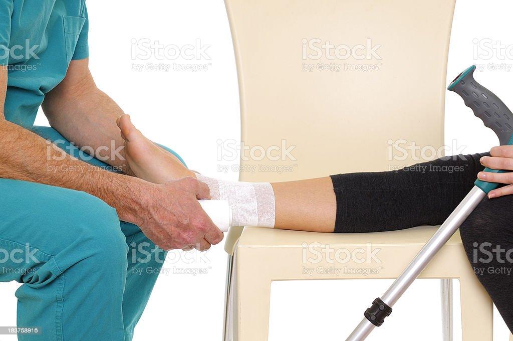 Doctor bandaging ankle