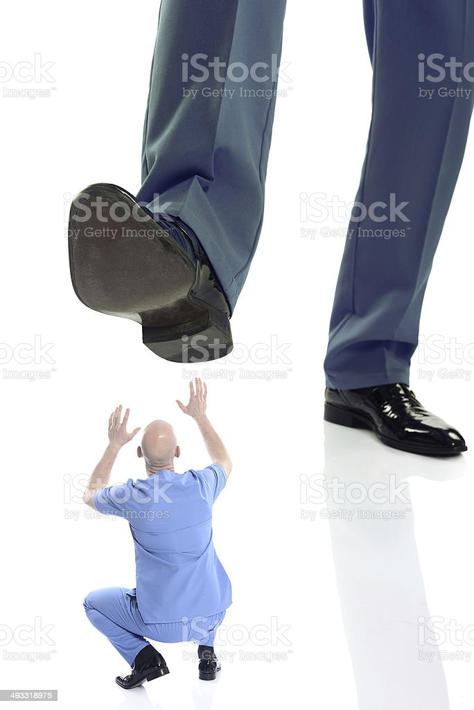 Doctor bullying mobbing stock photo