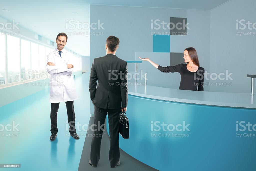Doctor, businessman and secretary at reception stock photo
