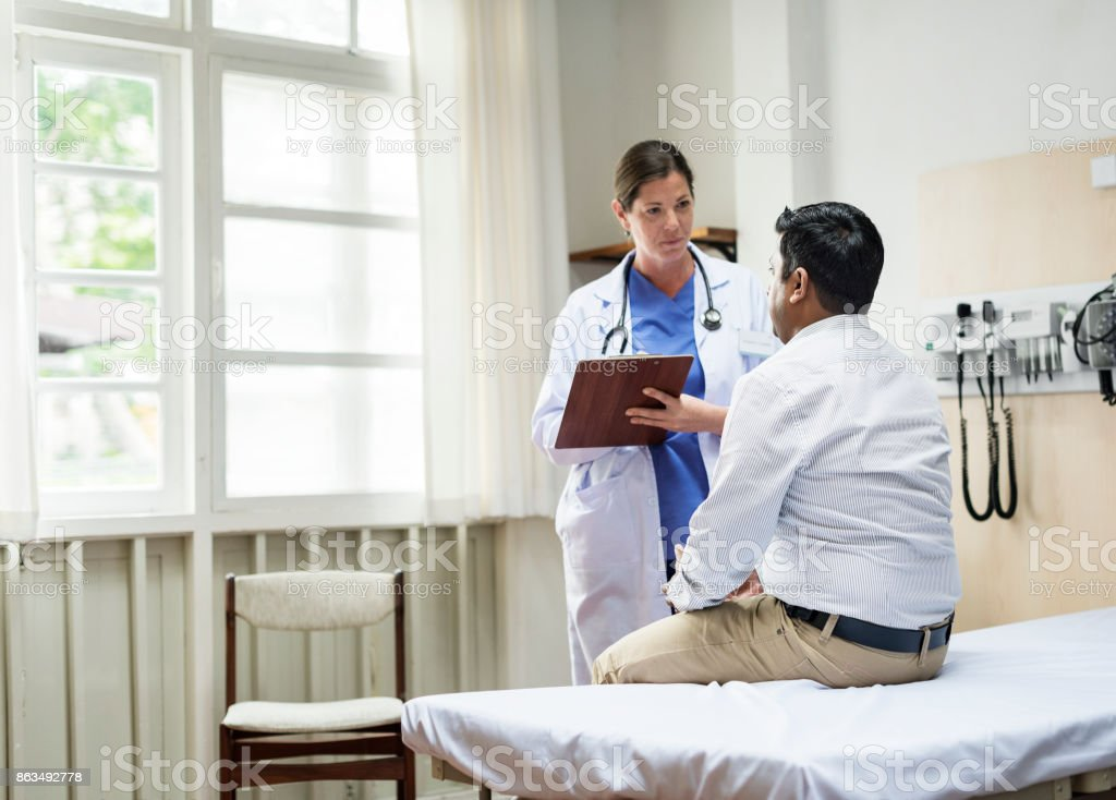 A doctor checking a patient stock photo