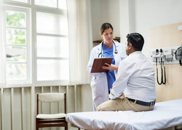 a doctor checking a patient - doctors checkup stock pictures, royalty-free photos & images