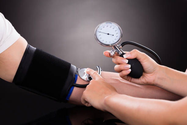 Doctor Checking Blood Pressure Of Patient stock photo