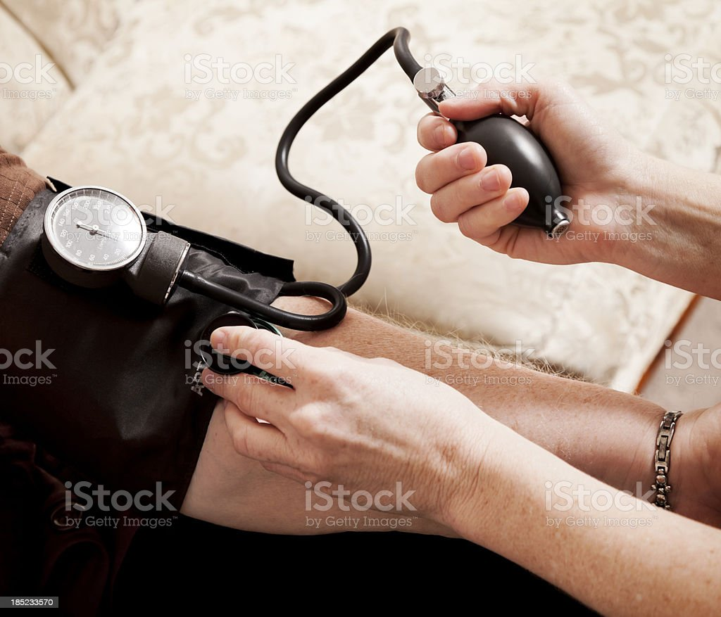 Doctor Checking Blood Pressure royalty-free stock photo