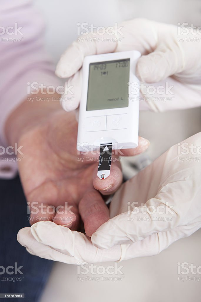 Doctor Checking Blood Sugar Level stock photo