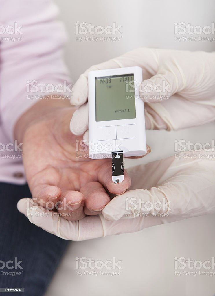 Doctor Checking Blood Sugar Level royalty-free stock photo