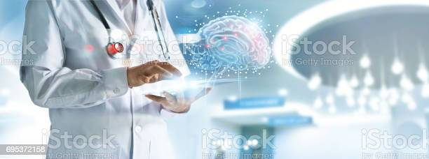 Doctor checking brain testing result with computer interface in picture id695372158?b=1&k=6&m=695372158&s=612x612&h=omij7ffifiacwnc0ievqszdxvirk9rwtfmlrgtbclza=