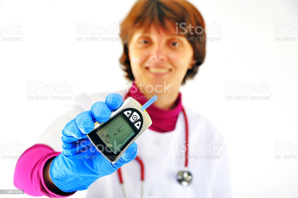doctor checking diabetic's blood sugar royalty-free stock photo