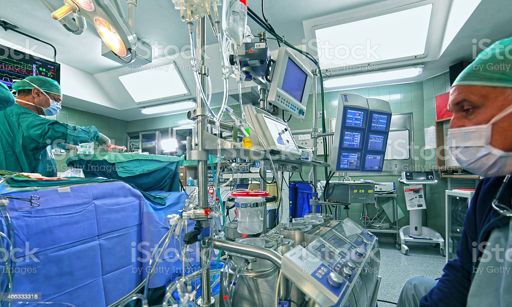 Doctor checking out data of cardiopulmonary bypass machine stock photo