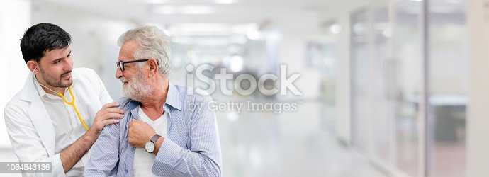 1064843136istockphoto Doctor checking patient health in hospital office. 1064843136