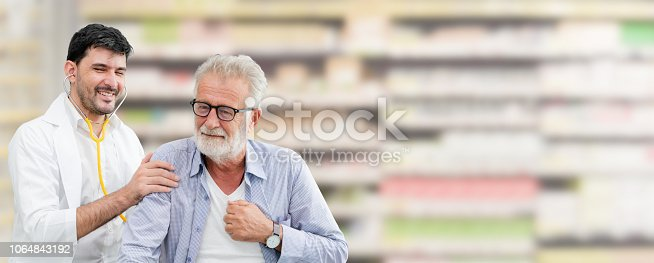 1064843136istockphoto Doctor checking patient health in hospital office. 1064843192