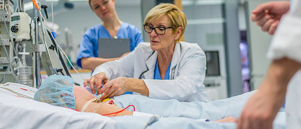 Doctor checking patient Doctor using respiratory equipment on patient in operating theatre. intensive care unit stock pictures, royalty-free photos & images