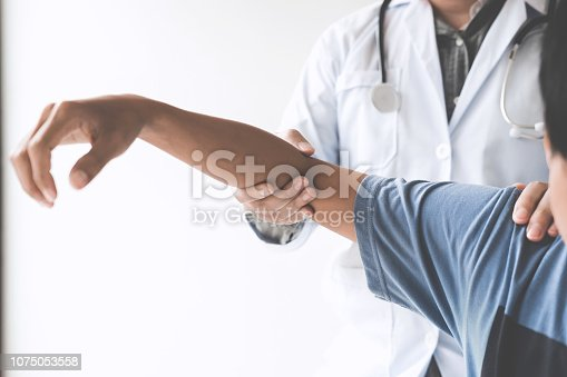 istock Doctor checking patient with elbow to determine the cause of illness 1075053558