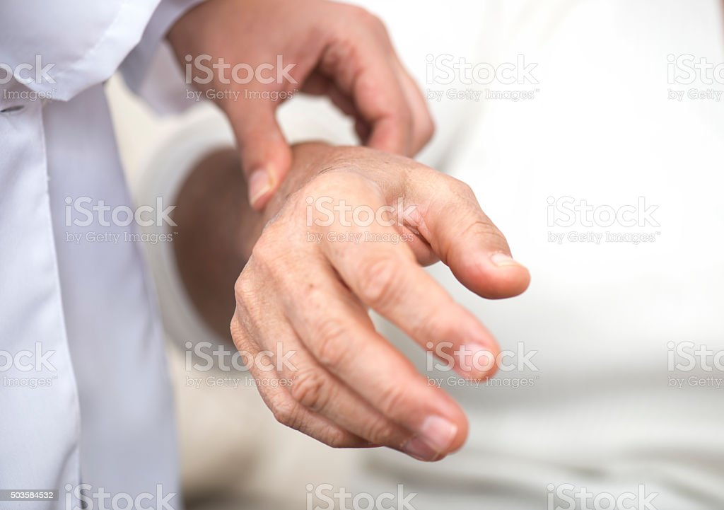 Doctor Checking The Pulse stock photo