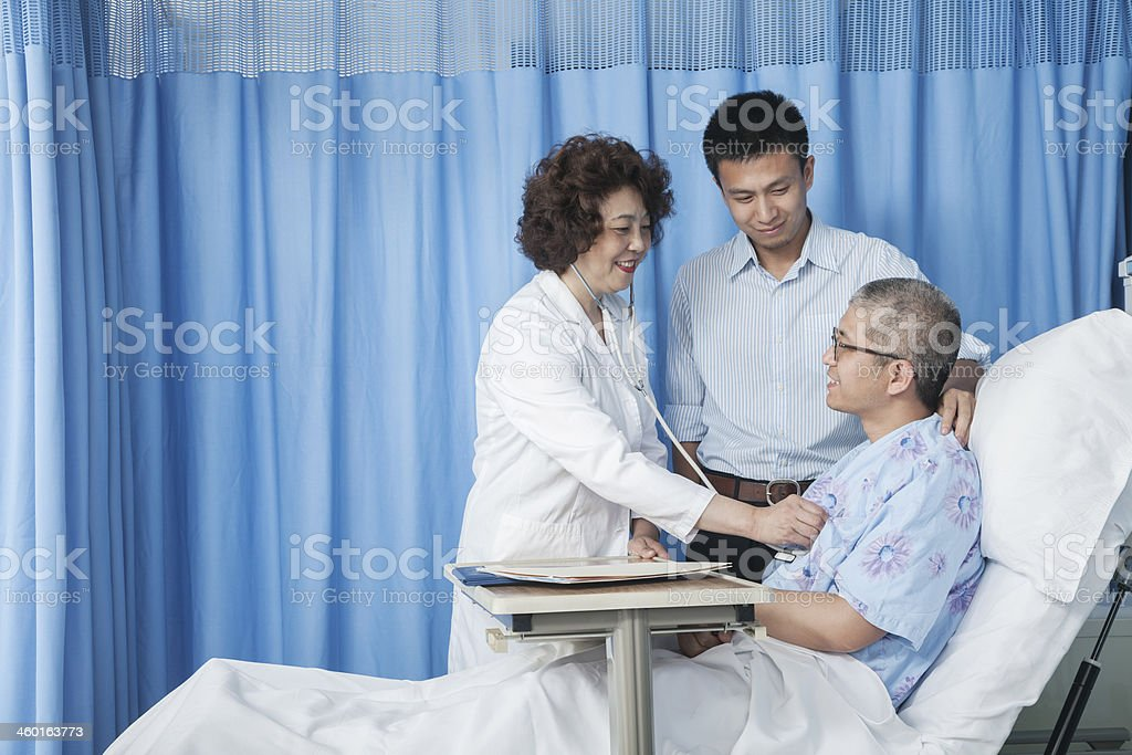 Doctor checking up on patient stock photo