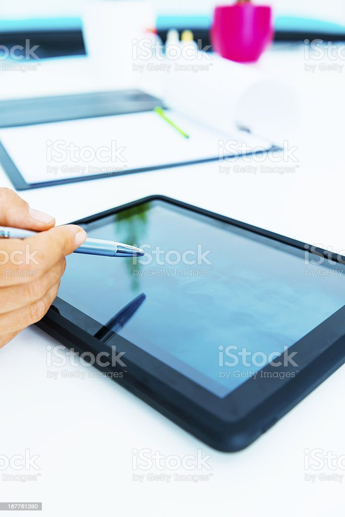 Doctor checking X-ray of spine on digital tablet royalty-free stock photo