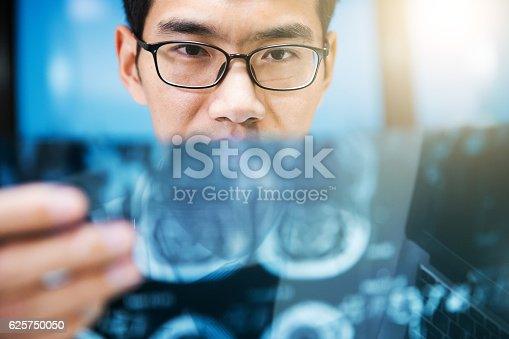 istock Doctor checking x-ray photo 625750050
