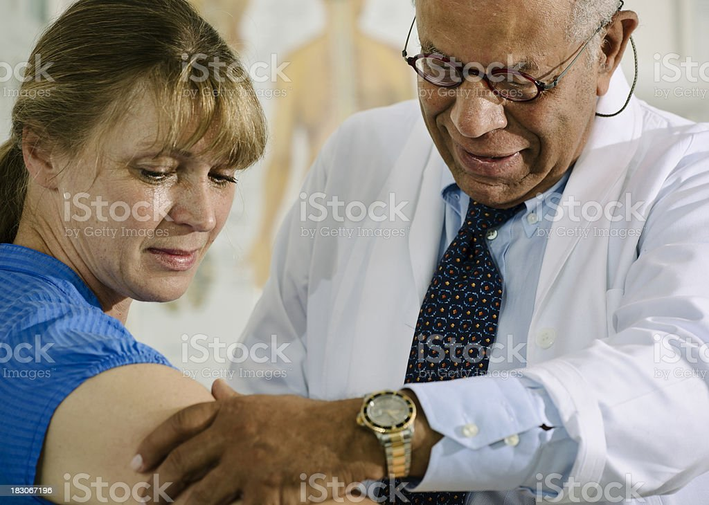 Doctor Checks the Arm of a Patient royalty-free stock photo