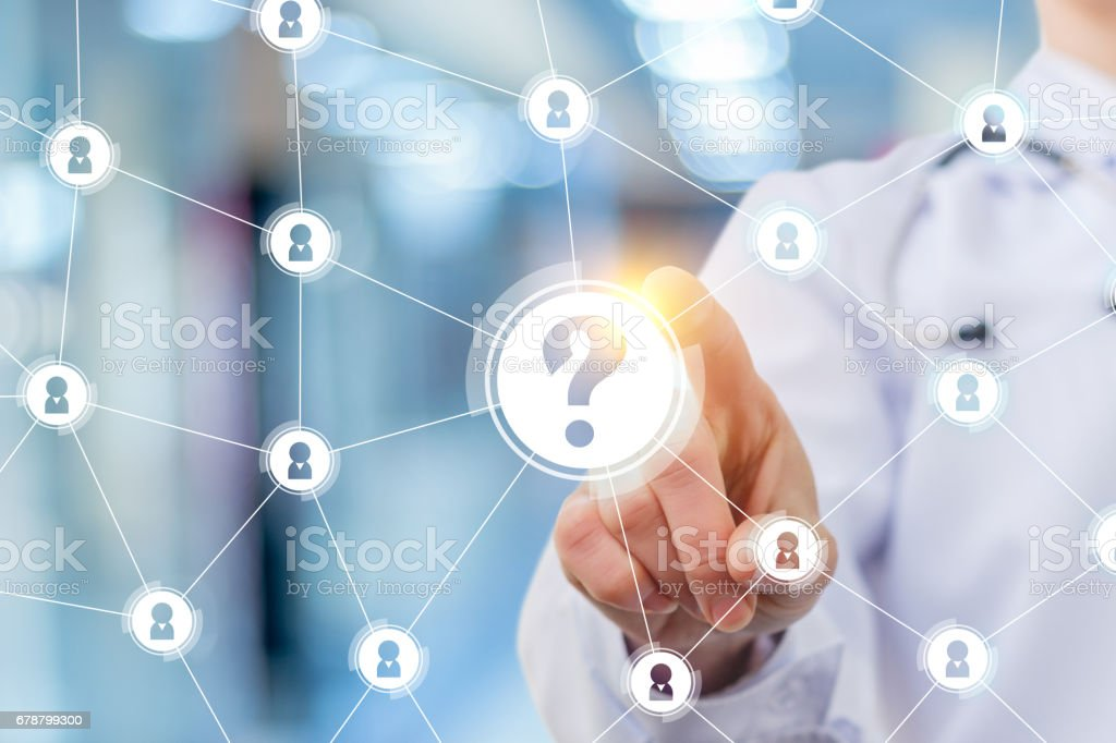 Doctor clicks on the question mark. stock photo
