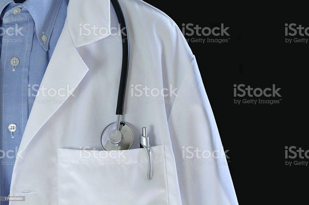 Doctor Coat on Dark Background royalty-free stock photo
