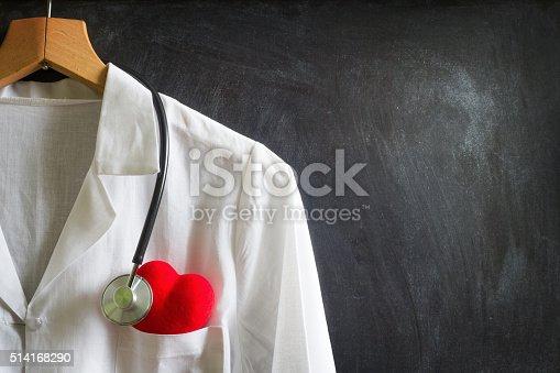 istock Doctor coat with stethoscope on blackboard 514168290