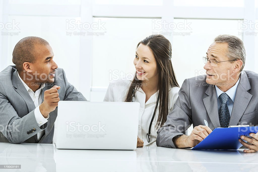 Doctor collaborating with a business team. royalty-free stock photo