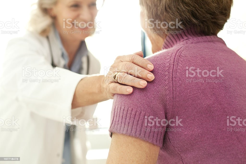 Doctor comforting a patient at the hospital stock photo