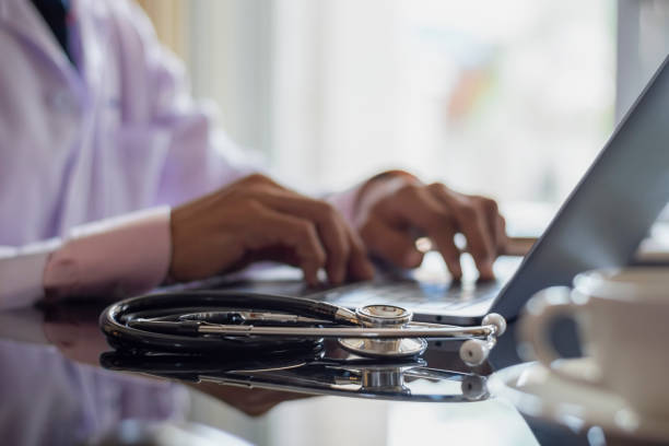 Doctor computer Doctor work and typing on modern laptop computer keyboard at office in clinic or hospital. medical technology stock pictures, royalty-free photos & images