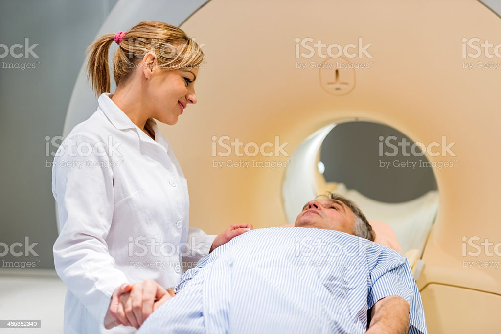Doctor consoling a patient before MRI scan. stock photo