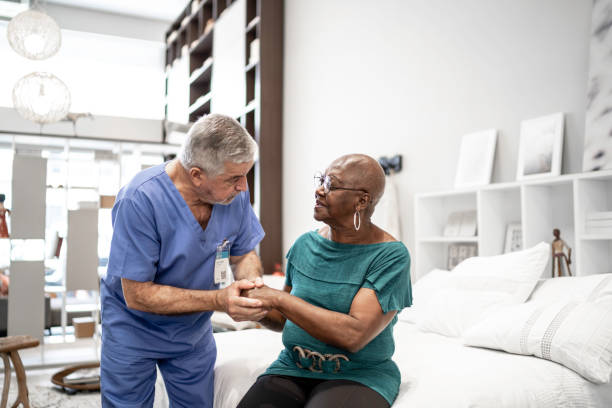 Doctor consoling a patient, holding hands Doctor consoling a patient, holding hands patience stock pictures, royalty-free photos & images