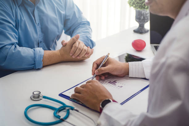 Doctor consultation with male patient health disease in medical clinic or hospital health. health and doctor concept. Doctor consultation with male patient health disease in medical clinic or hospital health. health and doctor concept. outpatient stock pictures, royalty-free photos & images