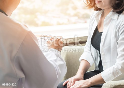 istock Doctor (obstetrician, gynecologist or psychiatrist) consulting and diagnostic examining female patient's on woman's obstetric - gynecological health in medical clinic or hospital healthcare service center 964904920