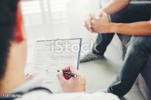 965324772istockphoto Doctor consulting and diagnostic examining with men's patient health disease and writing on prescription record information document visit patient's home 1137736784