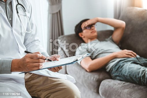 965324772istockphoto Doctor consulting and diagnostic examining with men's patient health disease and writing on prescription record information document visit patient's home 1137736794