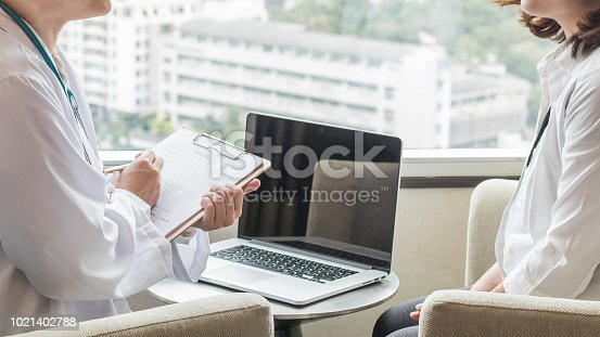 istock Doctor (obstetrician, gynecologist or psychiatrist) consulting and diagnostic examining woman patient's obstetric - gynecological health in medical clinic or hospital healthcare service center 1021402788