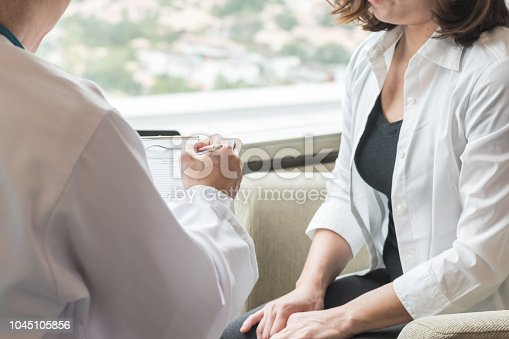 istock Doctor (obstetrician, gynecologist or psychiatrist) consulting and diagnostic examining woman patient's obstetric - gynecological health in medical clinic or hospital healthcare service center 1045105856