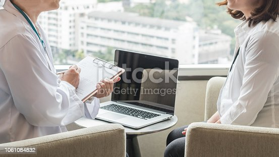istock Doctor consulting and examining woman patient health in medical clinic or hospital 1061084832