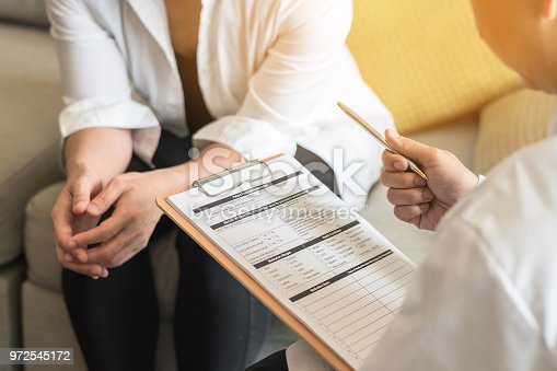 964904920 istock photo Doctor (gynecologist or psychiatrist) consulting and examining woman patient's health in medical clinic or hospital health service center 972545172