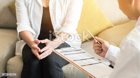 istock Doctor (gynecologist or psychiatrist) consulting and examining woman patient's health in medical clinic or hospital health service center 972918704