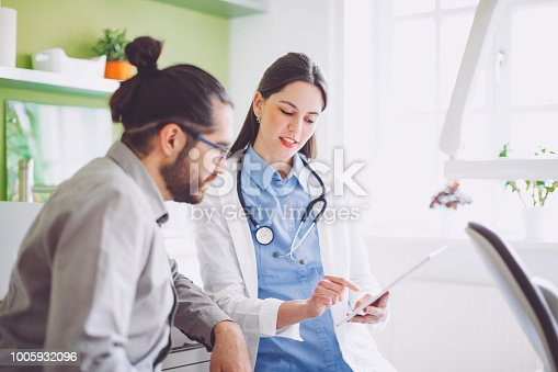 522625266 istock photo Doctor consulting her patient 1005932096