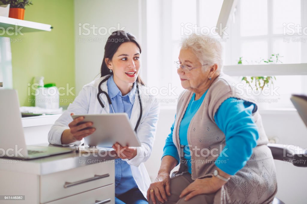Doctor consulting her patient stock photo