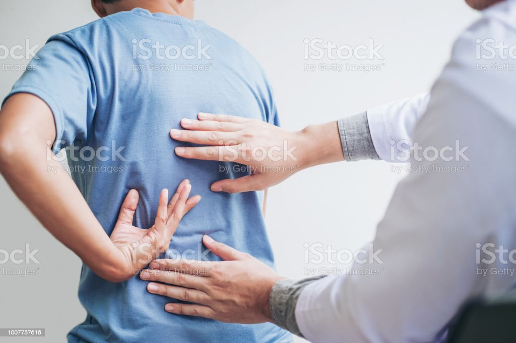 Doctor consulting with patient Back problems Physical therapy concept stock photo