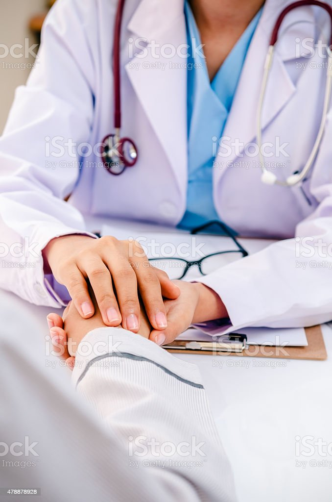 doctor consulting with patient stock photo