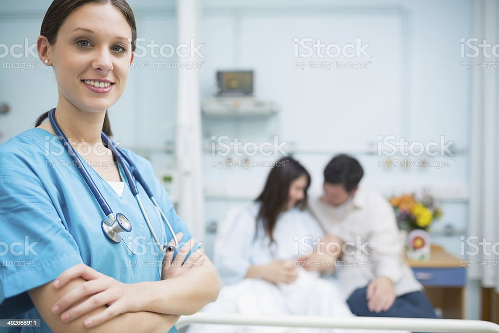 Doctor crossing her arms stock photo